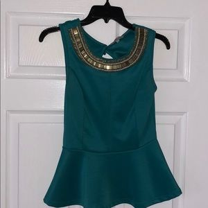 Teal peplum top with embellished neckline